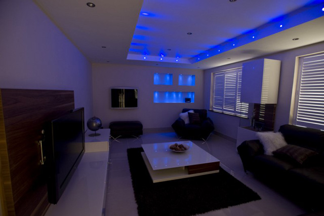 Led Lights Room : Feature Ceiling bulk head with blue led light and feature back wall.